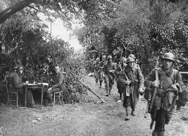 A French patrol moves through a wooded area to make contact with le Boche, June 3, 1940.