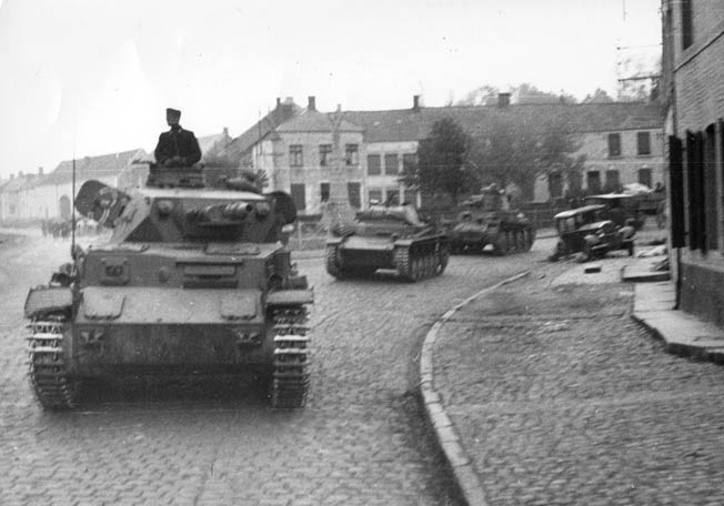 Another photograph taken by Rommel shows his panzers advancing through a French village. The Germans marched into Paris on June 14.