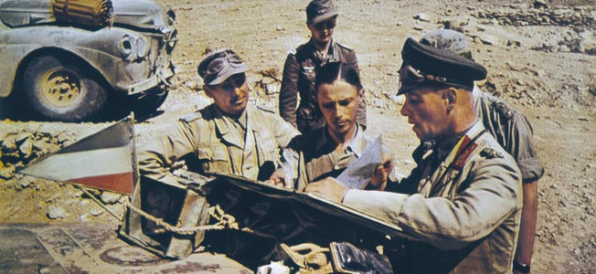 "North Africa : Rommel, nicknamed the ""Desert Fox"", commanding the Afrika Korps, consults battle plans with his staff Date: 1941 Source: Explorer Archives. Original photographed by Desmarteau."