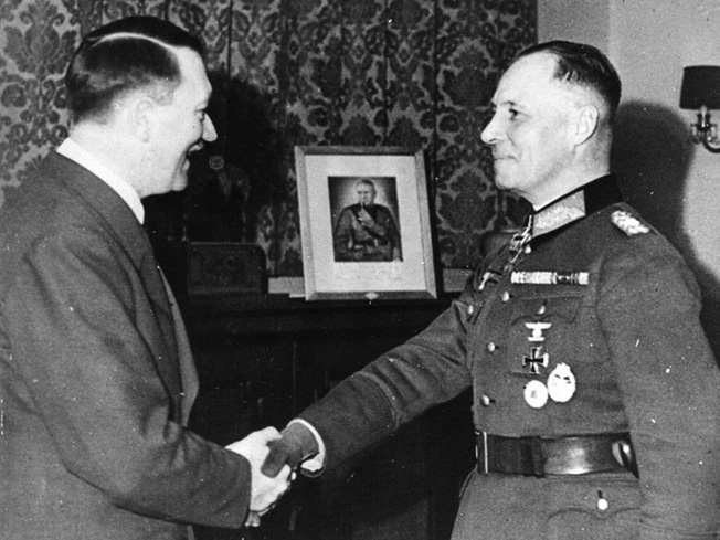 Hitler congratulates Rommel during the awarding of Oak Leaves to go with his Knight's Cross, March 20, 1942—before Rommel fell out of favor with Hitler.