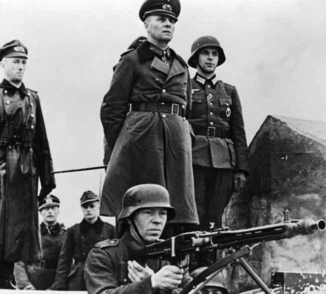 As head of Army Group B, Rommel was responsible for fortifying the French coast against invasion. Here he inspects German defenses in Normandy.