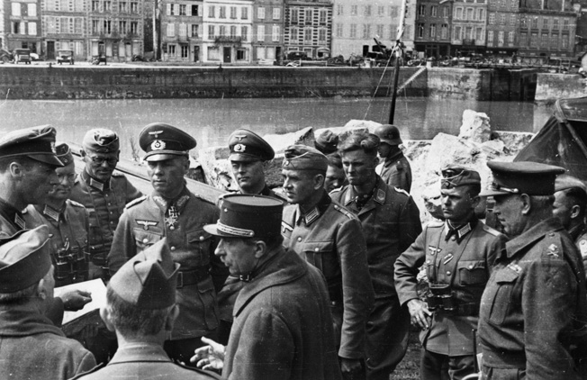 As commander of the 7th Panzer Division, Rommel accepts the surrender of French and British units during the invasion of France, 1940.