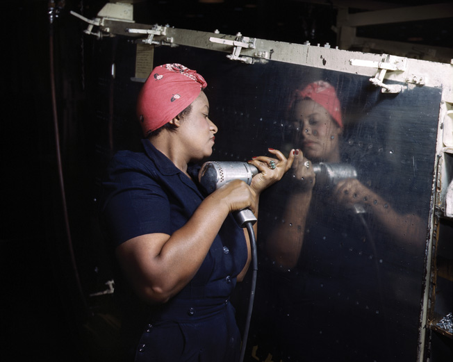 "Photographer Alfred Palmer captured another African American ""Rosie"" operating a power tool while working on an A-31 Vengeance dive bomber at Vultee Aircraft's Nashville, Tennessee, plant."