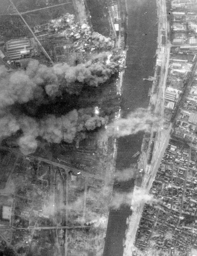 Thick black smokes rises along the river front as Marauder and Havoc bombers hit German forces fleeing the city, August 1944.