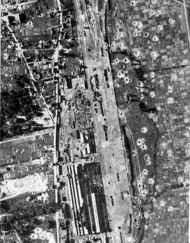 A damage-assessment photograph after an American air raid on July 8, 1944, on the Rouen-Sotteville marshaling yards shows extensive cratering; the Germans—and the French railroad workers—usually were able to repair the damage quickly.