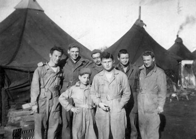 A shot of some members of the B-24 crew at their base in Cerignola, shortly before the plane was shot down. Thomas Rowe is at far right.