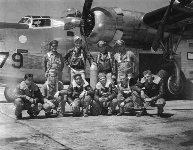 The crew of Rowe's B-24 (back row, left to right): Francis Deans, bombardier; Robert Crinkley, pilot; James Owens, co-pilot; Nathan Berliner, navigator. (Front row, kneeling): Rufus Breland, nose gunner; Wilbur Penno, radio operator; James Shipman, tail gunner; Walter Wright, belly-turret gunner; Thomas Rowe, flight engineer; Edwin Hand, top-turret gunner.
