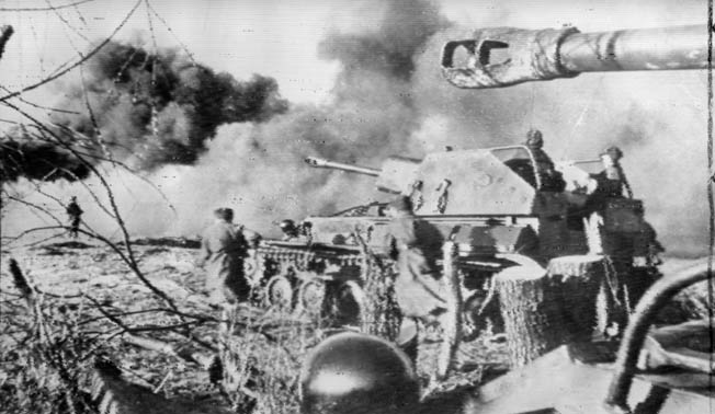 Supported by heavy self-propelled assault guns, Soviet soldiers advance rapidly toward the west and German territory in East Prussia.