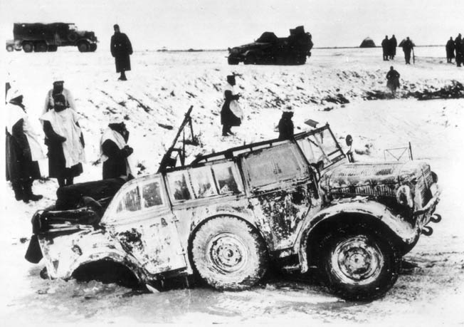 ABOVE: German soldiers, wearing sheets for camouflage against the Russian winter landscape and ill prepared for combat in such harsh conditions, seem perplexed by a vehicle that has become locked in ice during an attempt to cross a stream.