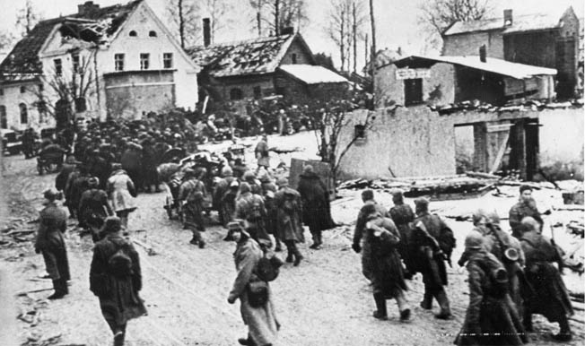 Soviet soldiers streaming through an East Prussian village during the followup Red Army offensive in early 1945. Within months, the Nazi capital of Berlin was in Soviet hands and World War II in Europe was over.