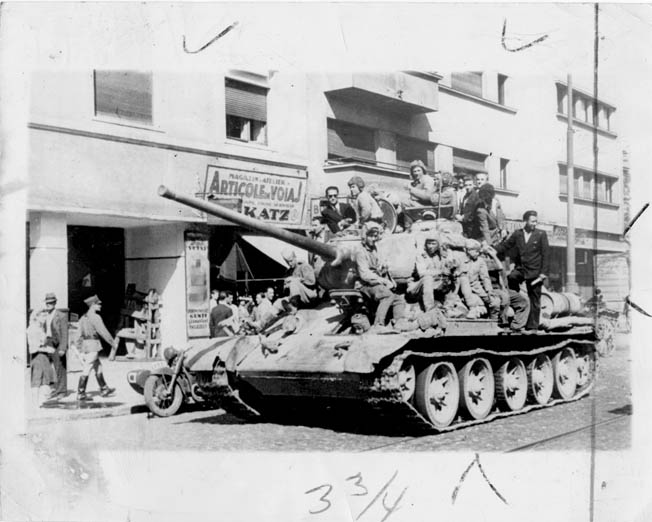 Victorious troops of the Soviet Red Army ride through the streets of Bucharest, Romania, as the capital city falls in the spring of 1945. The country had been an Axis partner under the rule of dictator Marshal Ion Antonescu. Soon after World War II ended, the communist faction in Romania solidified its power base with Soviet backing. Failed British diplomacy prior to the outbreak of World War II contributed directly to half a century of postwar communist domination of Eastern Europe.