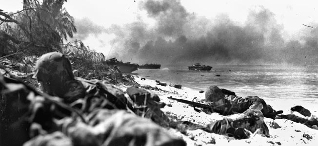 Smoke drifts over Red Beach as men of the 4th Marine Division crawl ashore during Operation Forager, June 15, 1944. More than 30,000 defenders tried to hold off more than 65,000 invaders.