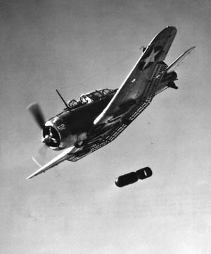 An SBD releasing its bomb. The Dauntless SBD-5 had a cruising speed of 185 mph, a top speed of 255 mph, a service ceiling of 25,000 feet, a range of 1,115 miles, and could carry 2,250 pounds of bombs.