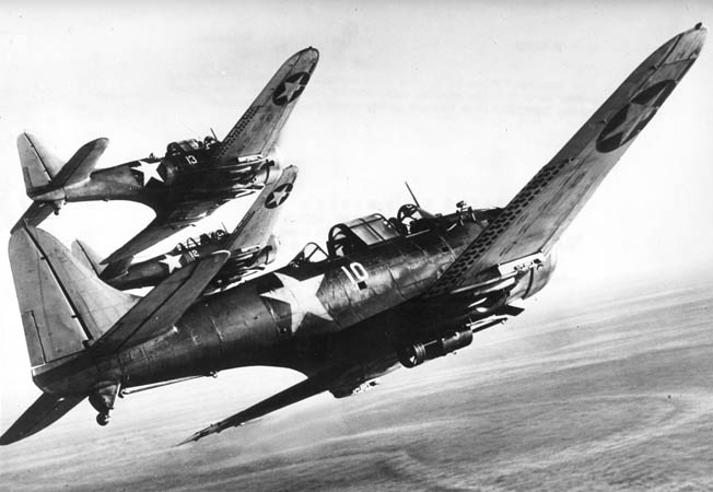 Three SBDs bank toward their target during a mission in the Pacific, 1943.