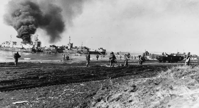 American troops land at Anzio on January 22, 1941, against light enemy resistance. The Luftwaffe did make an appearance and scored a hit on a supply ship, which burns in the background.