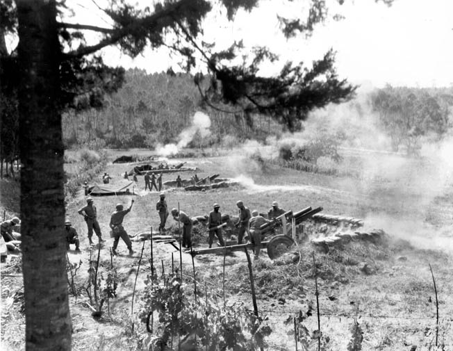 The first African American artillery unit in the Italian theater fires its 105s at German positions across the Arno River, August 29, 1944.