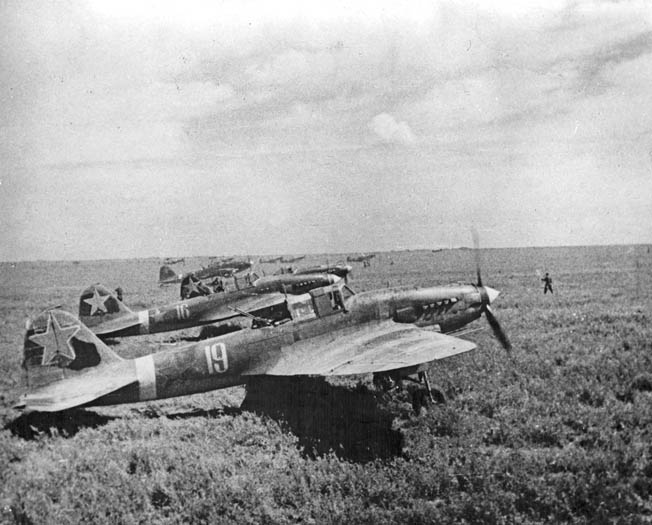 Their engines running prior to takeoff, a group of Shturmoviks sits ready to embark on a mission against the invading Germans.