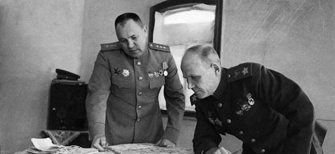 Red Army General Ivan Konev, at right, studying a map with a staff officer, commanded the 2nd Ukrainian Front and directed large numbers of tanks and troops against the Germans in the winter of 1943-1944.