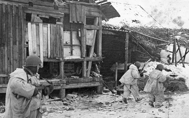 Camouflaged to blend in with the winter landscape, Soviet soldiers advance warily through a village near Kirovograd in the winter of 1943. At times during the campaign the fighting was house to house. Note the submachine gun carried by the soldier in the foreground. Such automatic weapons gave the Red Army tremendous firepower at the squad level.
