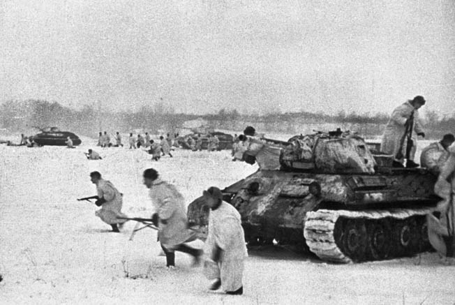 Dressed in snow camouflage, Soviet infantrymen, accompanied by T-34 tanks, charge German positions during a counterattack. The Red Army lost huge numbers of soldiers but always seemed to have an unlimited supply of reserves.
