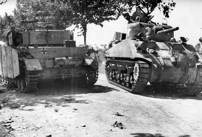 A Sherman tank advances past a destroyed German tank. The arrival of British and American reinforcements on September 14 gave the Allies additional strength and compelled the Germans to begin withdrawing toward Rome.