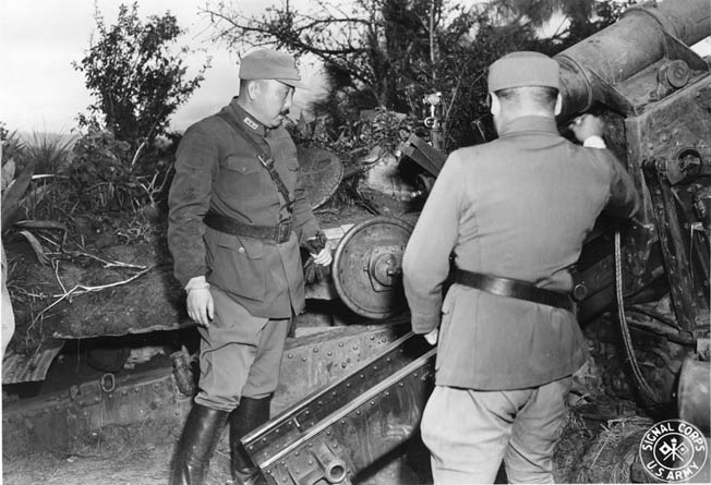 Chinese General Wei Li-huang, shown inspecting a gun on the Salween front, was scorned by U.S. commanders.