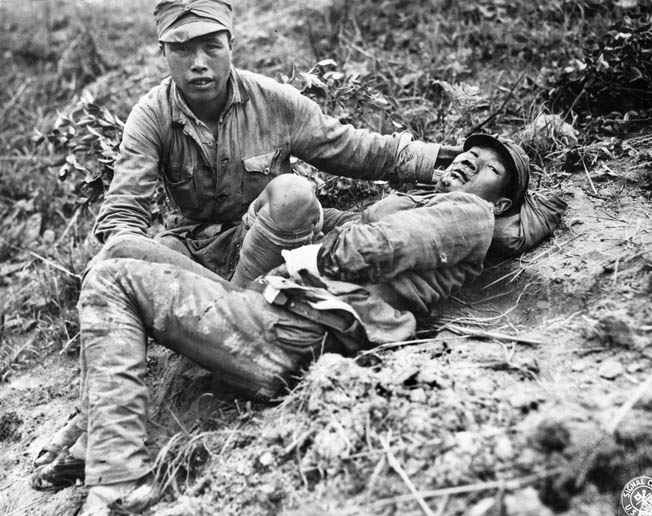 A Chinese soldier wounded by mortar fragments awaits medical attention. The courage of the Chinese soldier was seldom called into question, but many of those in command left a great deal to be desired.
