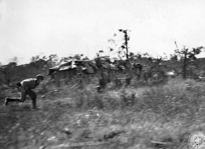 Massed Chinese troops charge Japanese positions under heavy fire. Americans were critical of Chinese tactics, which were often wasteful of human life.