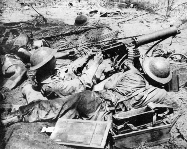 During heavy fighting at Buna, New Guinea, on January 1, 1943, George Silk took this photograph of Australian Diggers manning a Vickers machine gun. The Australians have recently taken Japanese sniper fire, which claimed the life of the soldier sprawled at far left. This photo was initially suppressed by Australian government censors.