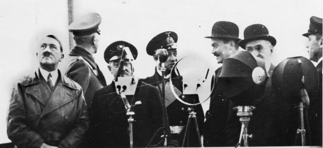 The battlecruiser Scharnhorst was launched in 1936. Hitler and other Nazi dignitaries, including Grand Admiral Erich Raeder, commander of the Kriegsmarine, to Hitler's left await the beginning of ceremonies.