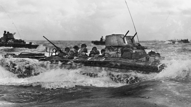 Marine landing craft churn toward the beach at Tinian in the Marianas on July 24, 1944. When these Marines went into action, General Harry Schmidt had just been given command of Fifth Amphibious Corps.