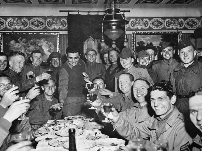 American GIs and Soviet soldiers toast the defeat of Germany. Private Sevel thought the Russians looked young but rough, and he felt that the Americans and Russians shared a camaraderie borne of combat.