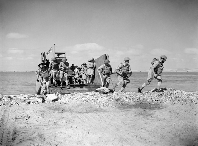 Using a North African beach to rehearse their role in the upcoming invasion of Sicily are British commandos and a Royal Navy beach party.