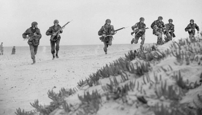 British paratroops train on a beach in North Africa prior to Operation Fustian—the British airborne portion of Operation Husky that began on July 10, 1943. The combined air and seaborne invasion of Sicily involved a total of 180,000 U.S., British, and Canadian troops, 3,200 ships, and 4,000 aircraft, and caused Italy to drop out of the war.