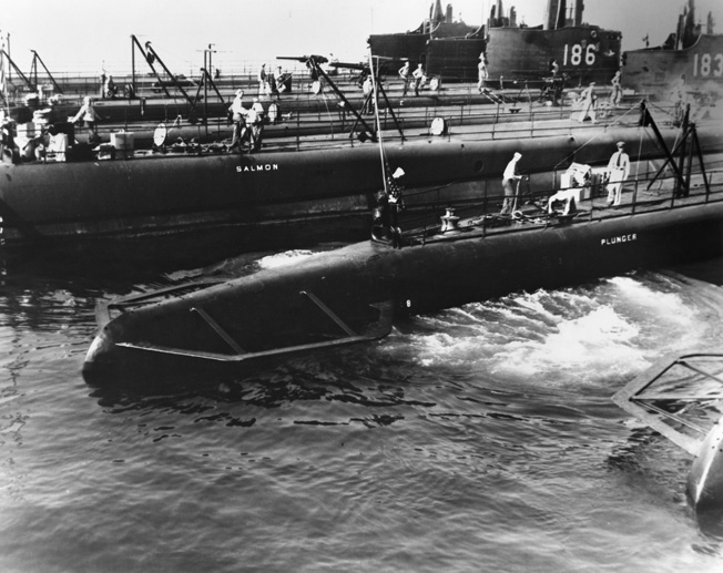 USS Plunger backs clear of other submarines, including Seal (SS-183, far right), alongside their tender in San Diego Harbor in 1940. The author, Ron Smith, joined the Seal crew in spring 1943.