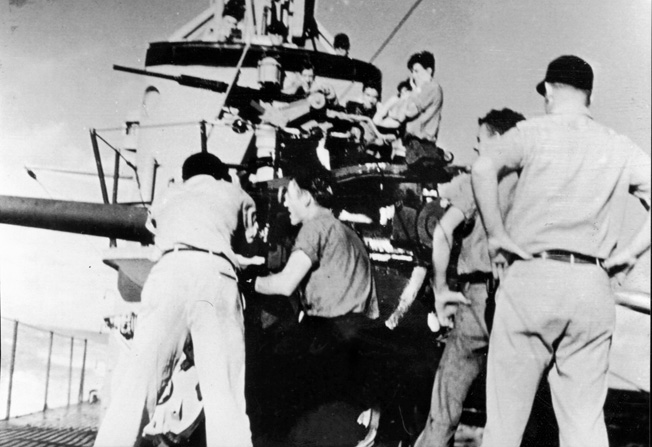 Ron Smith (circled) is visible during practice with Seal's five-inch MK40 deck gun. The Salmon-class Seal had a complement of five officers and 54 enlisted men.