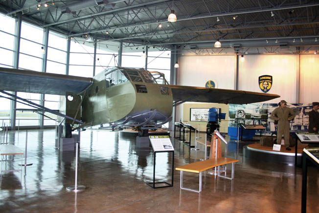Interior of the spacious main hall of the Silent Wings Museum with its centerpiece—a restored Waco CG-4A glider—on display.