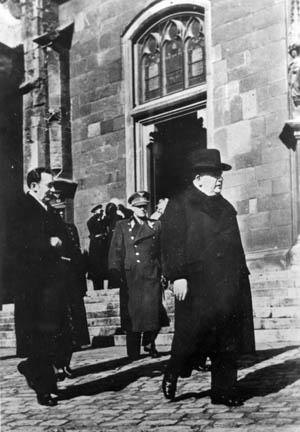 On March 20, 1944, during  observances of the fifth anniversary of the  Nazi occupation of Czechoslovakia, Father  Tiso leaves a Czech cathedral.