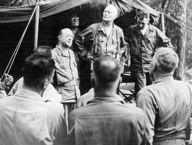 General Robert Richardson, senior commander of U.S. Army troops in the Pacific Theater, addresses staff officers of the 27th Infantry Division during his visit to Saipan after the relief of General Ralph Smith from command. Richardson did not consult Marine General Smith prior to visiting Saipan, and the Marine command establishment considered Richardson's tour of the island a serious breach of military protocol.