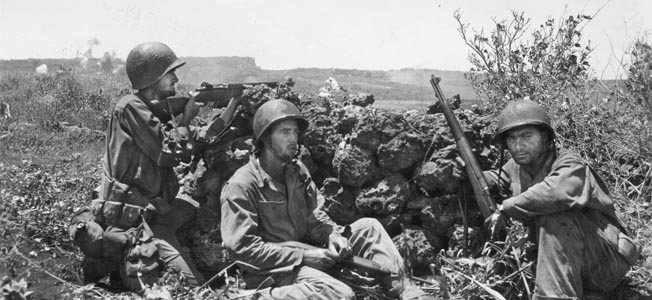 Soldiers of the 27th Infantry Division hold their position atop Nafutan Ridge, June 21. Marine General Holland Smith was unhappy with the Army division's performance and relieved their commander, Maj. Gen. Ralph Smith.