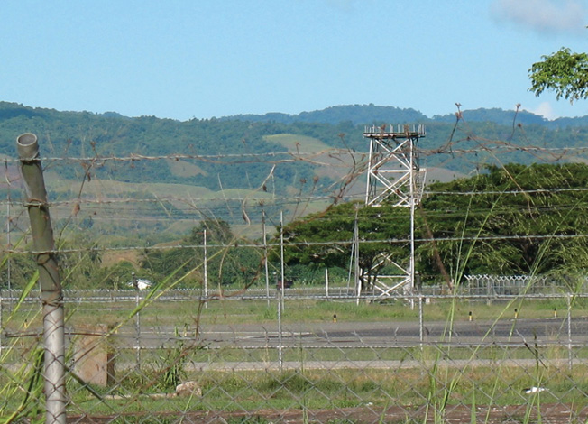 The skeleton of the Henderson Field control tower, built in 1943, sits on the edge of the runway of what is now known as Honiara International Airport.