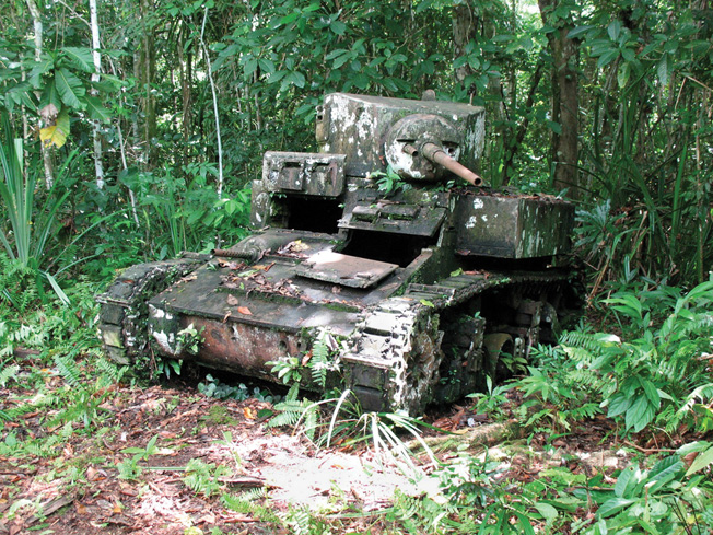 The rusted hulk of an M3 Stuart light tank is slowly being reclaimed by the jungle on the edge of a Bairoko Harbor village, New Georgia Island.