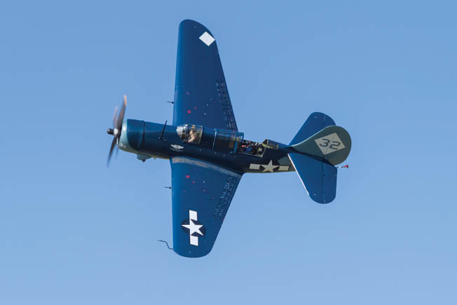 "On June 1, 2013, the Commemorative Air Force's Curtiss SB2C-5 Helldiver goes into the ""break"" on approach to an airfield at Manassas, Virginia, with pilot Ed Vesely at the controls and author Robert F. Dorr in the rear seat. This Helldiver is the only one in the world that remains in airworthy condition today"