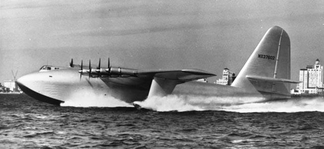 "The 300,000 pound H-4 Hercules (aka ""Spruce Goose"") kicks up a wake as its eight engines attempt to lift off from Long Beach (California) Harbor on its one and only flight, November 2, 1947—more than two years after the war."