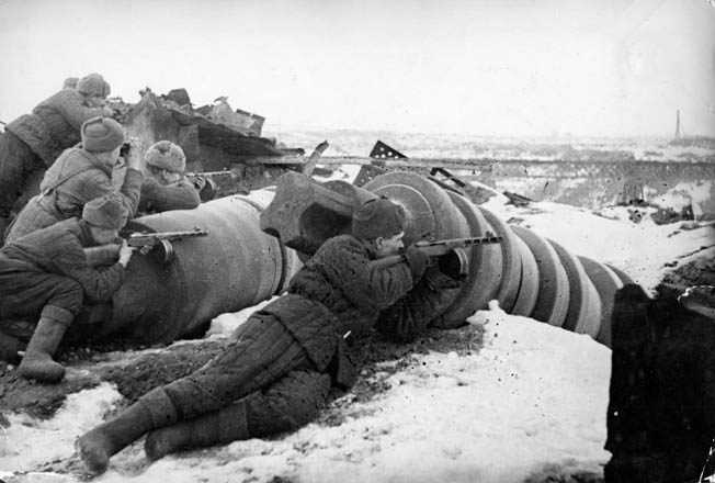 Soviet troops use the rubble of Stalingrad as cover while firing on German positions. With the Luftwaffe unable to transport more than a fraction of the needed supplies to the Germans in Stalingrad, the situation was nearly unbearable.