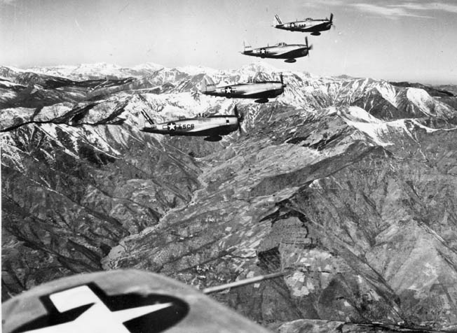 P-47 Thunderbolt fighter bombers with belly fuel tanks en route to an attack in Italy's Northern Apennine Mountains, April 1945.
