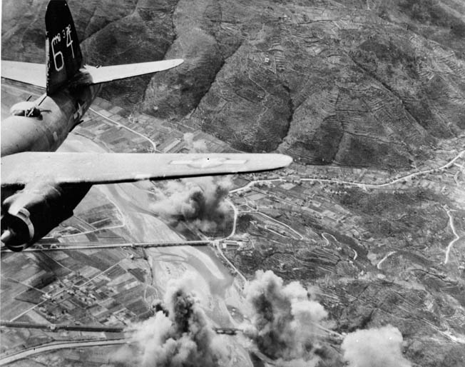 Having released its bombs, a B-26 Marauder heads for home after attacking strategic rail bridges near La Spezia on Italy's west coast, April 1944. Such raids rarely produced the extensive damage the U.S. Army Air Forces claimed, nor slowed enemy train or vehicular traffic for long.
