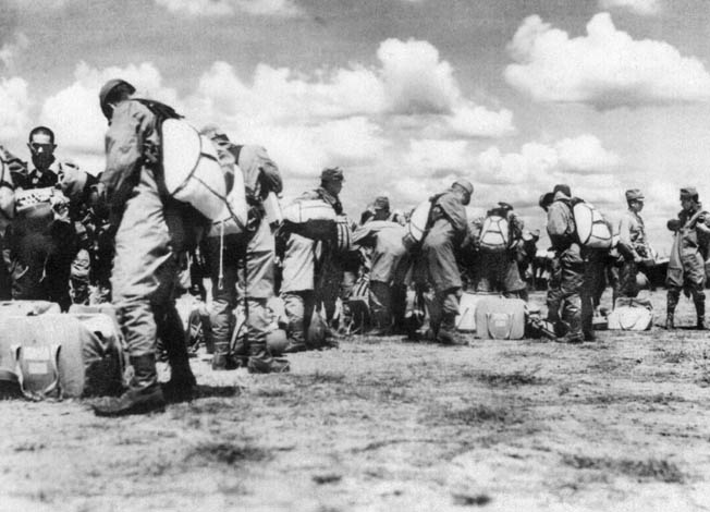 In preparation for their airborne assault on Palembang and the island of Sumatra, Japanese airborne troops of the 2nd Raiding Regiment don their parachutes. The airdrop on Sumatra was one of only a few such Japanese operations mounted during the Pacific War.