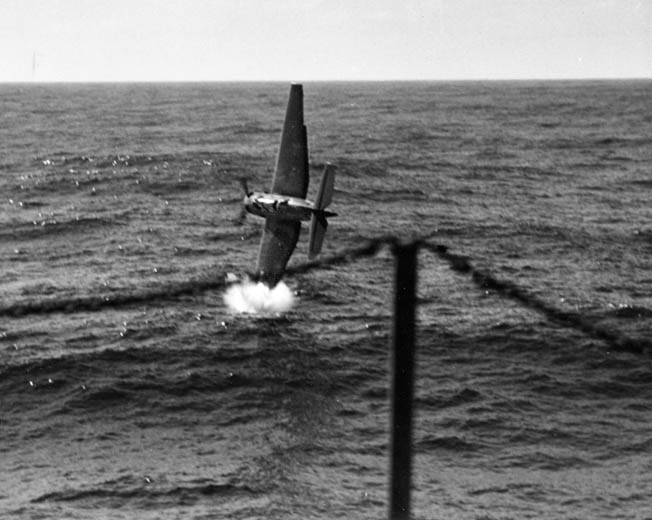 After catapulting off the USS Anzio's deck, Lieutenant B. Sevilla's TBF drops its port wing into the ocean.
