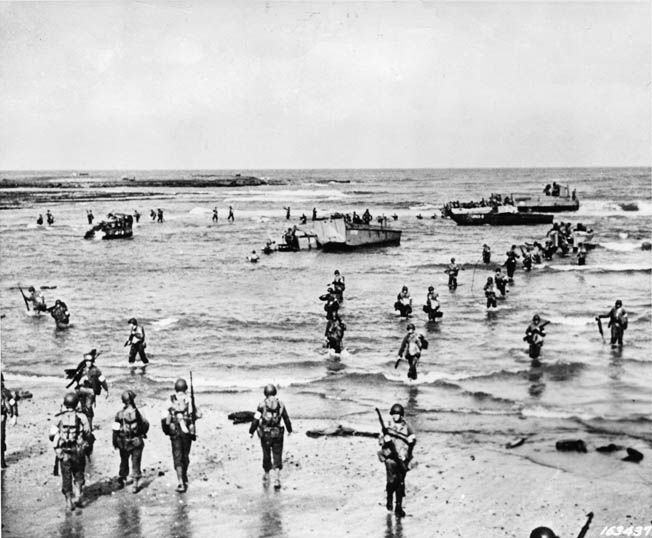 The U.S. Army had virtually no experience in amphibious operations by the time Operation Torch commenced in November 1942, and the extent of that inexperience was painfully evident during the opening hours of the offensive in North Africa. In this photo, American soldiers walk and stumble through the surf on a North African beach. When General Lucian Truscott came ashore, he found chaos.